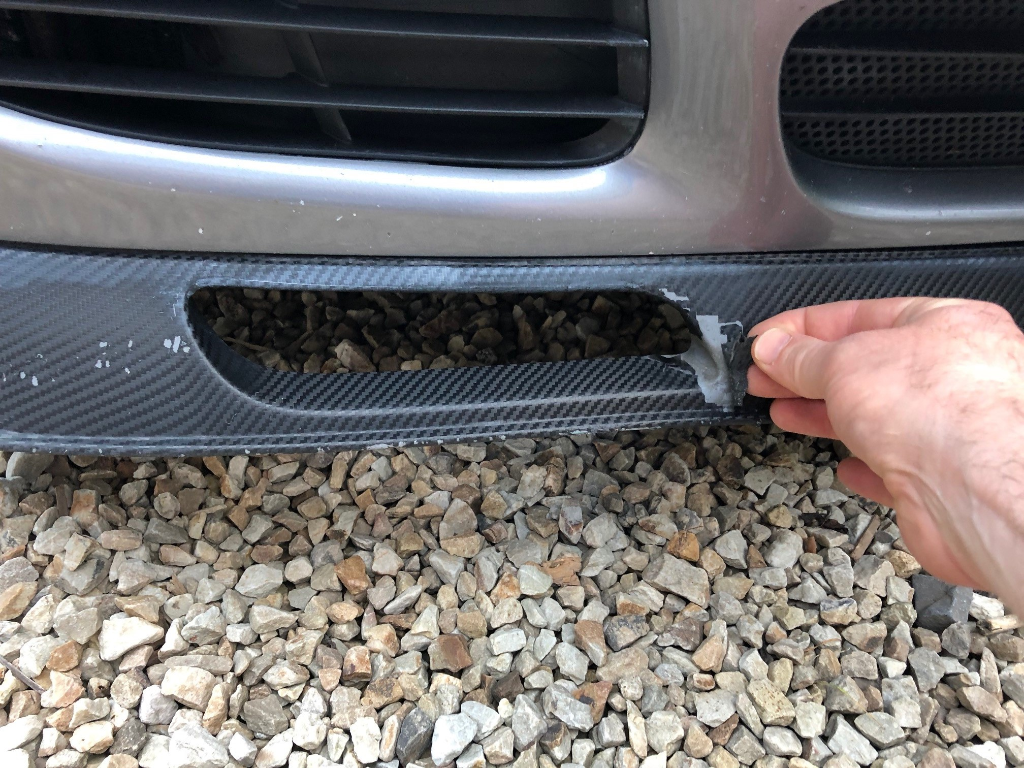 Front Splitter Carbon Wrap tear.jpg